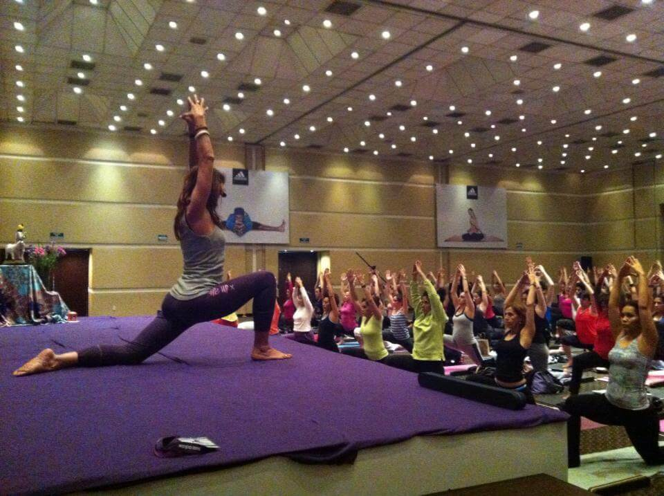 Brigitte Longueville teaching at the 9th national yoga conference with the Back Mitra